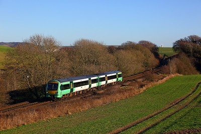 171729 on the 1G26 1133 Ashford International to Brighton passes Ashcombe Windmill, Kingston near Falmer on the 28th December 2017