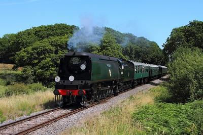 34070 on the 1400 Swanage to Norden at Quarr Farm on the 9th July 2017