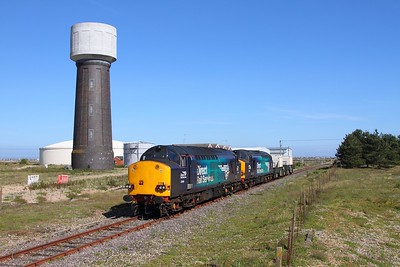 37069+37059 6M95 Dungeness to Crewe passing the Water Tower at Dungeness on the 1st June 2017