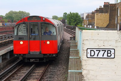 A westbound Piccadilly line service passes D77B at Stamford Brook on the 7th May 2017