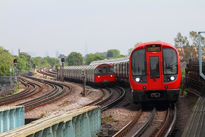 21319 on an Ealing Broadway district line service about to be overtaken by a Piccadilly service at Chiswick Park on 7th May 2017
