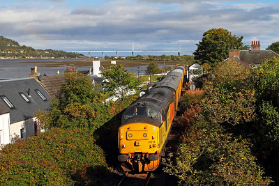 37219 tnt 37421 on the 1Q78 Inverness to Inverness via Kyle passes Beauly Firth at the former station site at Clachnaharry  Kessoch bridge is in the background  01 10 17