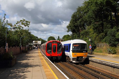 165019 on the 2C27 1248 Aylesbury to London Marylebone at Chorleywood passing S Stock 21099 on the 9th September 2017