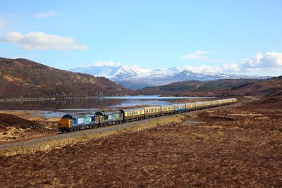 37259+37605 on the 1Z37 Inverness to Kyle of Lochalsh at Loch a'Chuilinn on the 1st April 2018
