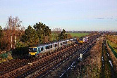 185103 on the 1P68 0857 Middlesborough to Manchester Airport passes 142065 on 2Y70 Sheffield to York at Colton junction on the 10th December 2018