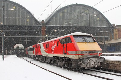 A frozen 91106 on the rear of the 1E09 Edinburgh (from Newcastle) to London Kings Cross at Kings Cross having been dragged south by 67010  The train would go to Bounds Green restricted at 40mph  2nd March 2018