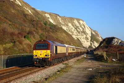 67021 tnt 67024 on the 1Z71 London Victoria to Folkestone West exits Abbotscliffe Tunnels at Capel le Ferne on the 17th November 2018