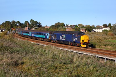 37423 tnt 37409 on the 2J80 Norwich to Lowestoft at Norton Marshes as it comes off the Reedham swing bridge on the 24th September 2018