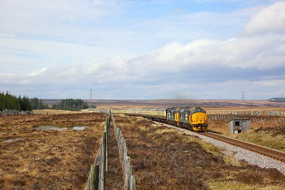 37409+37402 on the 1Z26 0815 Aviemore to Thurso away from Forsinard on the 21st April 2019