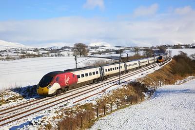 390020 on 1S48 0930 London Euston to Glasgow passes 390149 on 1M11 1040 Glasgow to Euston at Docker on the 2nd February 2019