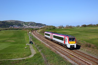 175107 on the 1H91 1544 Llandudno to Manchester Airport at Deganwy on the 4th May 2019