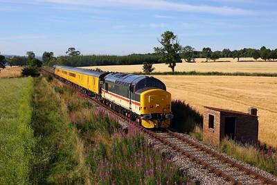 37419 leads 37402 on 1Q78 Inverness Millburn yard circular via Thurso and Wick at Evanton on 9 August 2020