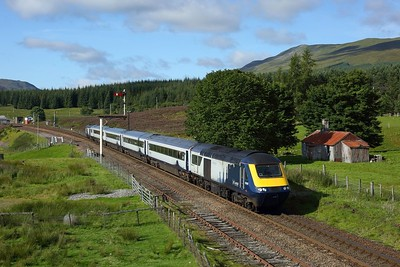 43140 leads 43030 on 1H05 0707 Glasgow Queen Street to Inverness departing Dalwhinnie on the HML on 8 August 2020