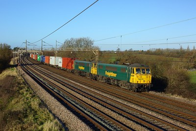 86639 leads 86613 working 4L97 Trafford Park to Felixstowe at Chelmscote on 17 December 2020