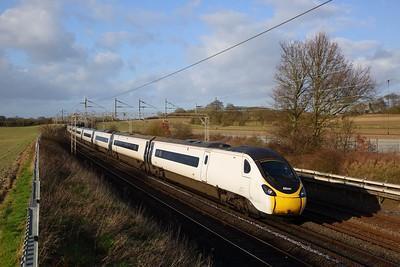 390115 on the 9M52 0853 Edinburgh to London Euston at Cow Roast on the 1st February 2020