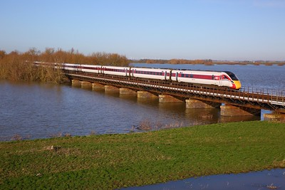 800111 on the 1Y24 1000 Newcastle to London Kings Cross crosses the Hundred foot drain - Ouse Washes at Pymoor south of Manea on the 19th January 2020