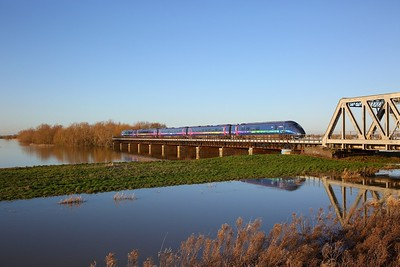 802301 on the 1A93 1119 Hull to Cambridge crosses the Hundred foot drain - Ouse Washes at Pymoor south of Manea on the 19th January 2020