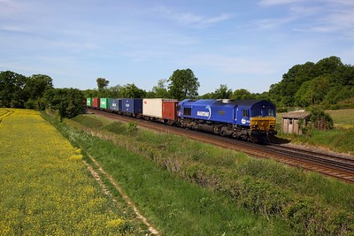 DB Cargo Maritime liveried 66051 hauls 4M71 0949 Southampton Western Docks to Birch Coppice intermodal at Oakley near Worting junction on the SWML on 20 May 2020