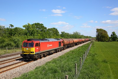 DB Cargo 60063 powers the 6B33 Theale to Robeston empty murco bogie tanks passing Hungerford up loop on the 14th May 2020