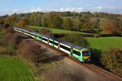 171721 leading 171401 on 1E23 1207 London Bridge to Uckfield at Blackham on 5 November 2020