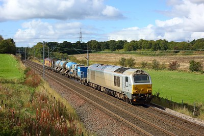 67012 leads 67020 working 3S93 Stirling to Slateford RHTT at Manse Road, Bargeddie east of Easterhouse on 1 October 2020  NorthClydeline, DB, Class67