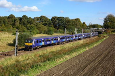 320303 leading 318259 on 2E57 1346 Airdrie to Balloch approaching Easterhouse at Manse Road, Bargeddie on 2 October 2020  Class320, Scotrail, NorthClydeline