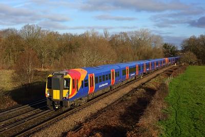 458518 leading 458522 working 2C21 0909 London Waterloo to Ascot at Egham on 17 January 2021  Class458, SWR, WaterlooReadingline