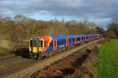 458514 leading 458527 working 2C23 0939 London Waterloo to Ascot at Egham on 17 January 2021  SWR, Class458, WaterlooReadingline
