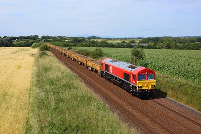 66084 powering 6K36 1125 Dumfries to Carlisle North yard approaching Gretna Green on 24 July 2021  DB66, GSW, Engineers, DBCargo, Class66