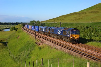 66429 leading 66422 on 4M48 Mossend to Daventry at Wandel on 29 June 2021  DRS66, DRS, WCMLScotland, ClydeValley