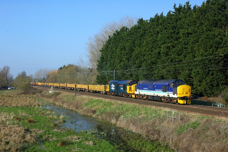 37425 leads 37424 on 6P01 0500 Thorpe-Le-Soken to Whitemoor yard at Ely North junction on 22 March 2021  Class37, DRS, FenLine