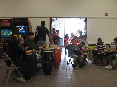 Superstar Carlos has arrived (he is Visalia's own drummer who has traveled to Africa to drum with the best) and the kids are drumming.