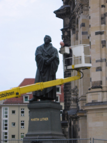 This guy looks like my history of christianity professor, Felak. I like it that he is cleaning a statue of Martin Luther... still in Dresden.