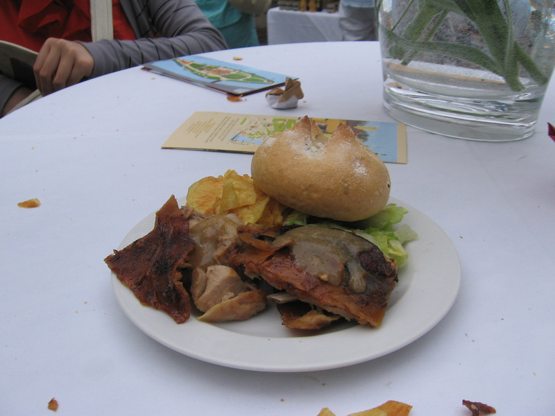 A plate of delicious roasted pig with great skin, homemade chips, salad and a role. (Naturally the 6 of us shared everything)