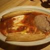 Cisco's Huevos Rancheros with potato spears and refried beans.