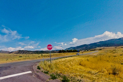 Stop Sign and Mountains