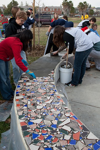 Volunteers completing the mosaic bench.