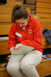 Nicole Horn, City Year Cleveland AmeriCorps member, removes library labels from books donated by the Cleveland Kids' Book Bank.