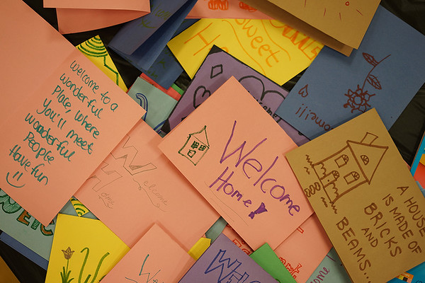 """Volunteers made dozens of """"Welcome Home"""" cards for Habitat for Humanity."""