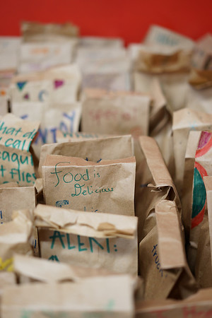 Volunteers decorated the paper lunch bags for the peanut butter & jelly sandwiches for The Metanoia Project.