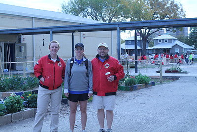 City Year Staff Member Lia, Rotarian Rachel, and City Year Board Chair Craig prepare for a day of service at the Advanced Learning Academy, December 2017.