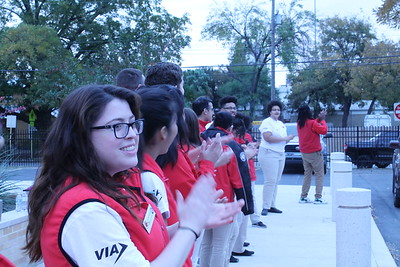 The City Year AmeriCorps members Power Greet students as they arrive to school at the Advanced Learning Academy.