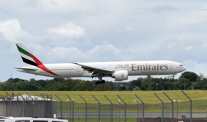 Emirates Airlines Boeing 777-300 A6-ENF landing at Birmingham Airport with a flight from Dubai.