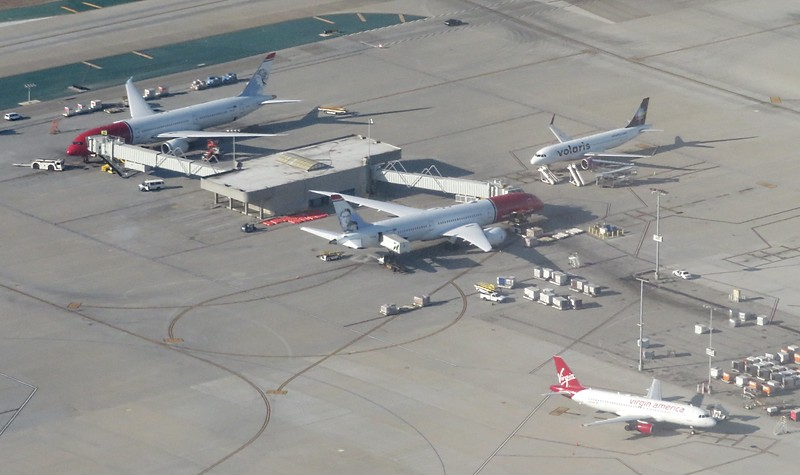 Two Norwegian Air International Boeing 787 Dreamliners share space with a Volaris Airbus A320 NEO and a Virgin America Airbus A320 at Los Angeles International, 06.07.2018.
