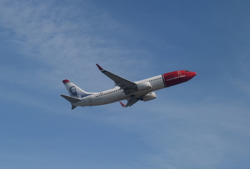 Norwegian Air International Boeing 737-800 EI-FHX taking off from London Gatwick.