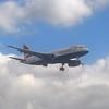 British Airways Airbus A320 G-GATS landing at London Gatwick.