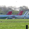 Withdrawn Avro RJ aircraft at Cranfield Airport, including Swiss G-CFAC, Air Libya SA-FLA, Cityjet G-CEHA, Brussels Airlines OO-DWD, another CityJet example and Formula 1 liveried G-OFOA, 01/05/2018.