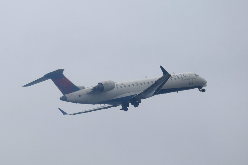 A Delta Connection Bombardier CRJ-700 takes off from New York LaGuardia.