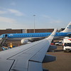 Disembarking at Amsterdam Schipol on KLM Cityhopper Embraer E190 PH-EXA with another E190 beside.