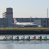 British Airways Cityflyer Embraer E170 G-LCYG being passed by a rowing boat at London City Airport, 17.02.2018.